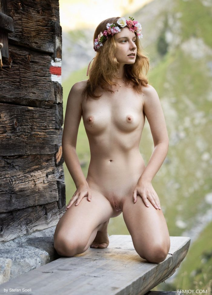 Cute girl Sienna R naked outside near a mountain cottage