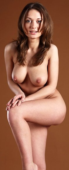 Gorgeous brunette Polly E shows her big tits with hard nipples