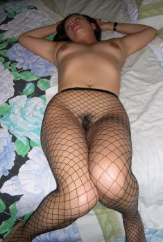 Sleeping sexy brunette in fishnet tights