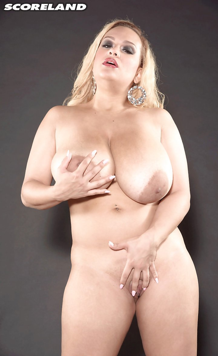 Blonde MILF Liza Biggs releasing huge boobs from bikini in high heels