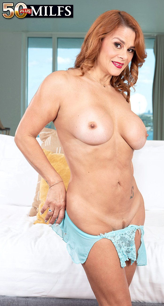 Latina MILF Juliett Russo playing with a blue dildo