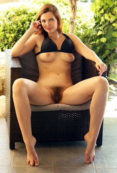 Redhead with red lips Felicia Vina shows hairy pussy