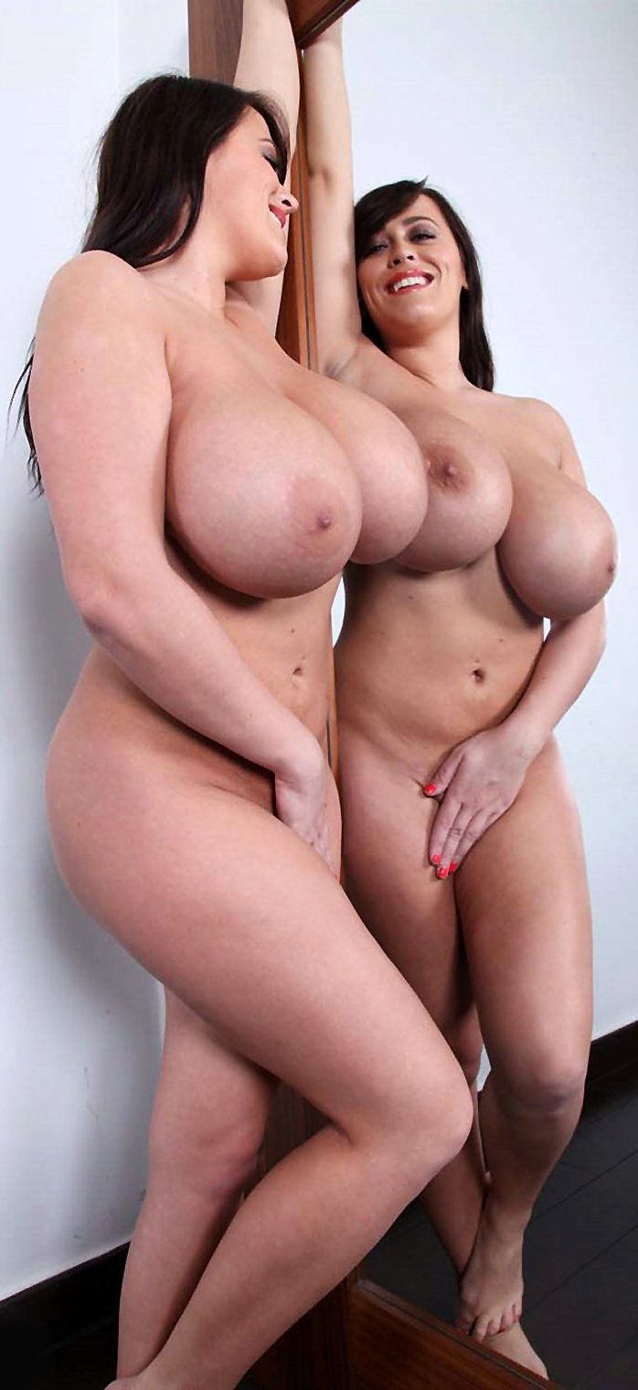 Brunette with huge boobs Leanne Crow next to the mirror