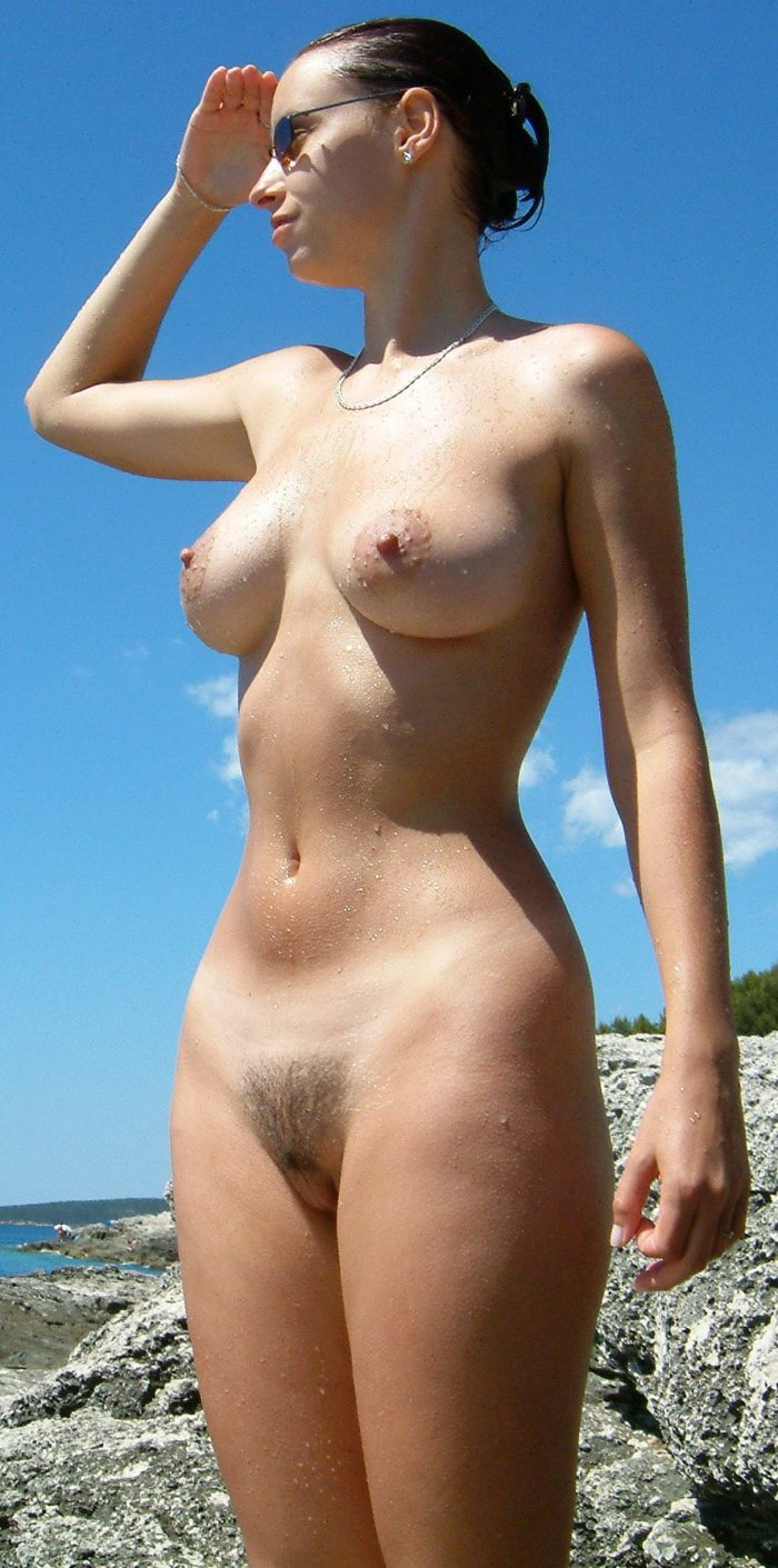 Busty brunette with hairy pussy naked outdoors