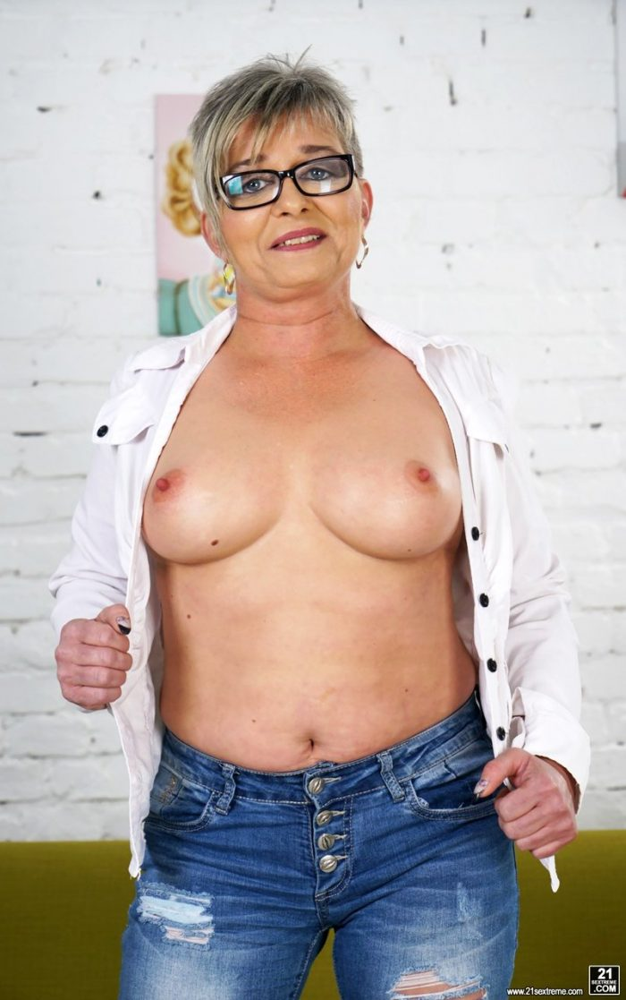 Mature granny Jessye sheds tight jeans to display nice tits and ass
