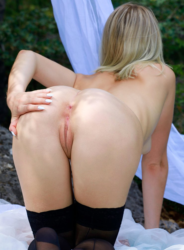 Russian blonde Libby shows her perky tits and spreads her ass