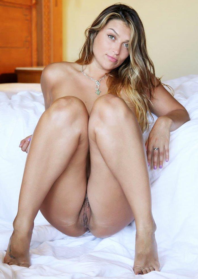 Seductive girl Verona strikes sexy nude poses with her toenails painted
