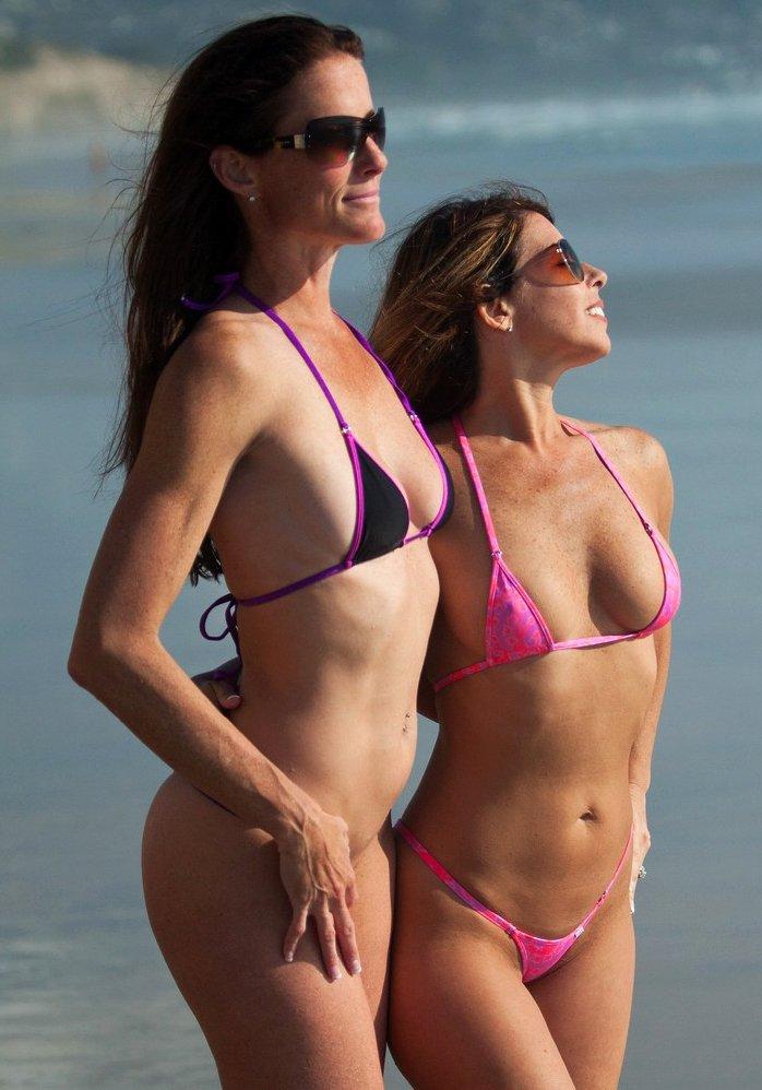 Sofie Marie and Yummy Niki on the beach in a sexy bikini
