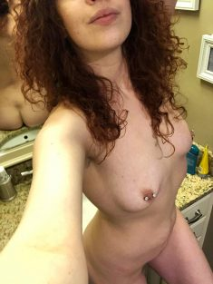 Amateur curly brunette with pierced nipples