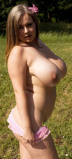 Constance Devil flaunts her huge tits and masturbates in the grass
