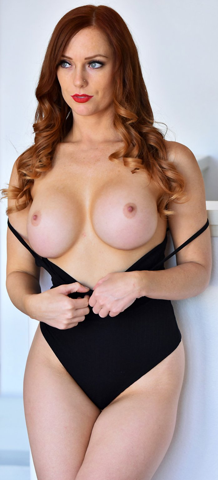 Redhead MILF Dani Jensen shows her big fake boobs