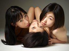 Three beautiful Asian dols sensually pose naked together