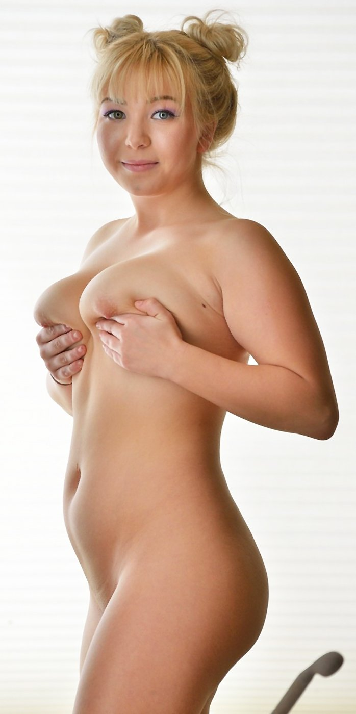 Young busty girl Velvet Rain posing nude in bathroom