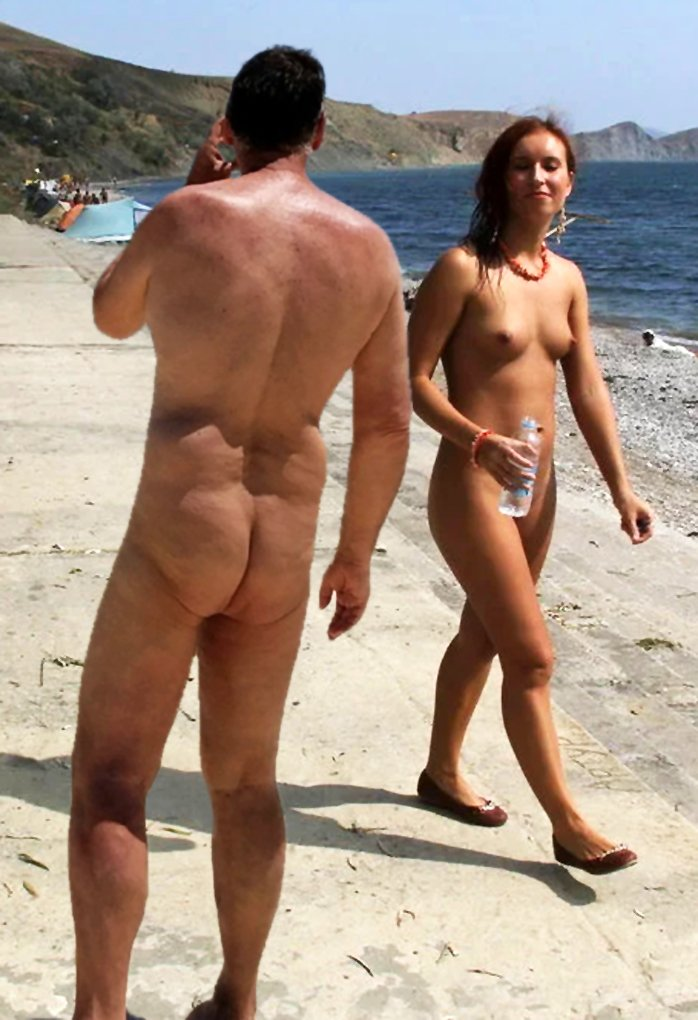 True nudist on the beach with a naked girl