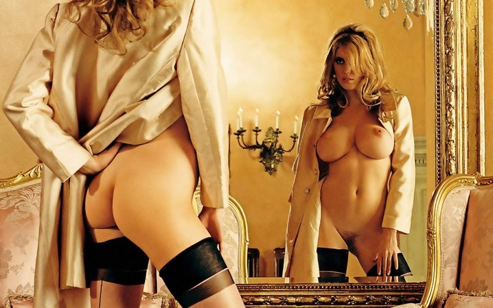 Lovely busty blonde Diora Baird posing naked in front of a mirror