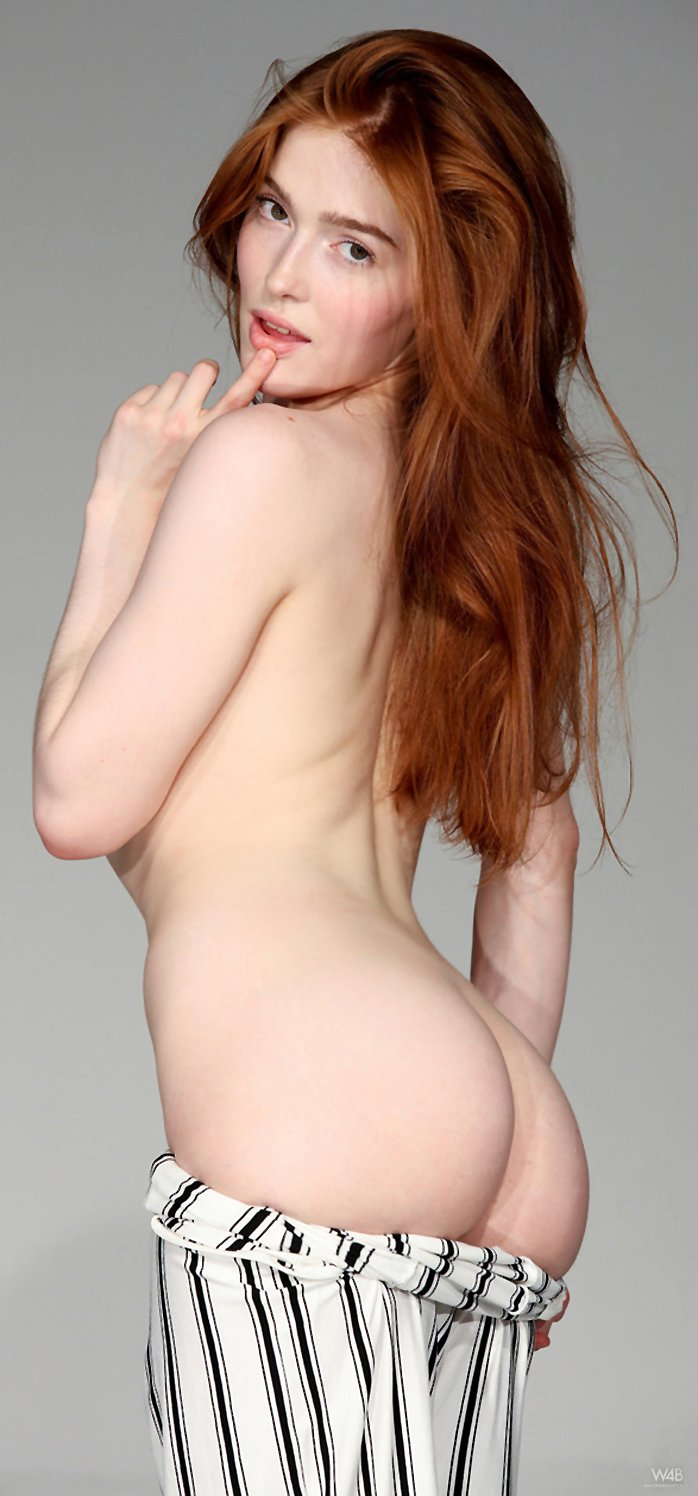 Redheaded Russian Jia Lissa shows her trimmed pussy and small boobs