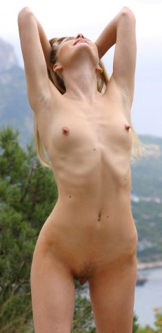 Slim amateur blonde with tiny tits naked in nature