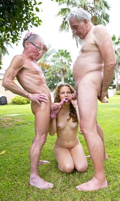 Young girl Bunny Babe gives oral pleasure to two old men in public