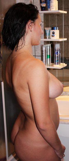 Busty brunette in the bathroom