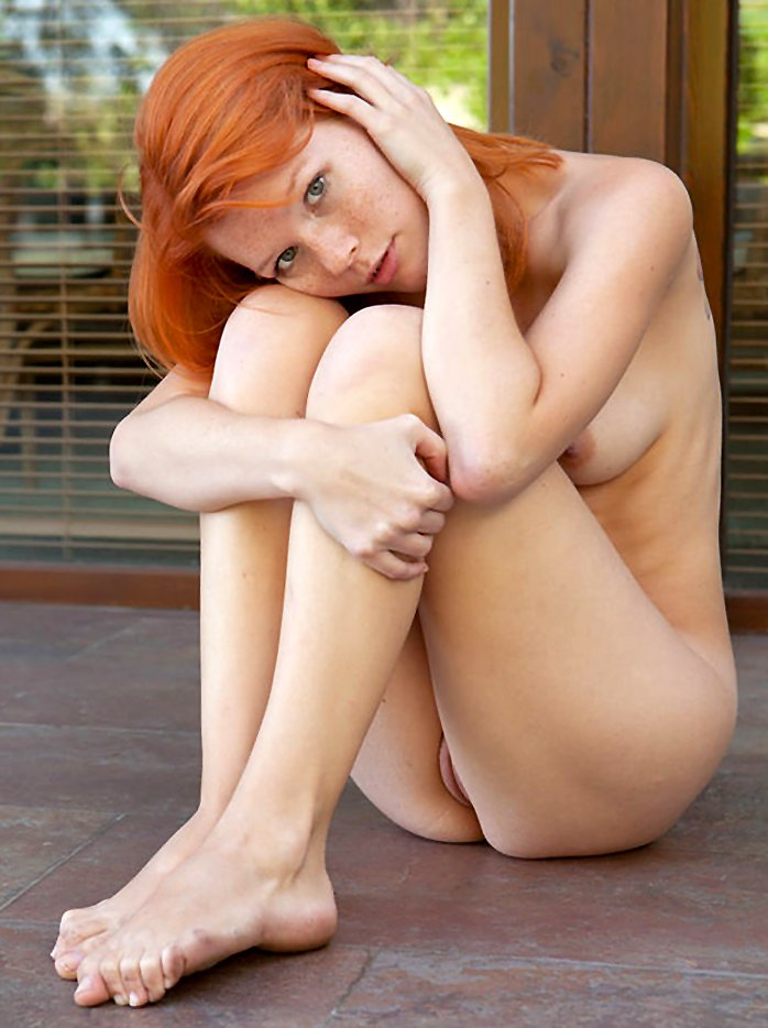 Freckled redhead Mia Sollis revealing perky tits and shaved pussy