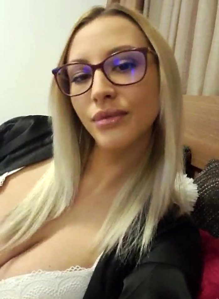 Hot blonde with big boobs in sexy glasses
