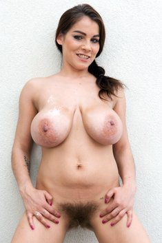 Brunette with big boobs Mischel Lee spreads her hairy pussy